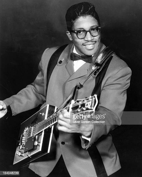 American guitarist and singersongwriter Bo Diddley with his trademark rectangular guitar circa 1958