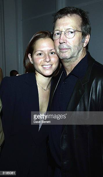 American guitarist Eric Clapton and wife attend the cocktail party to celebrate Giorgio Armani Retrospective at the Royal Academy on October 14 2003...