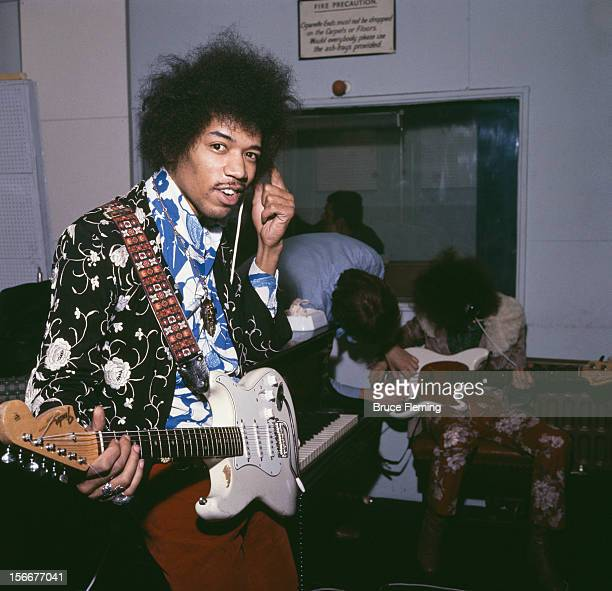 American guitarist Jimi Hendrix of The Jimi Hendrix Experience in a London recording studio October 1967 In the background is bassist Noel Redding