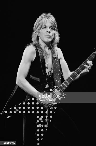 American guitarist Randy Rhoads playing a Karl Sandoval polka dot flying V guitar on stage with English rock singer Ozzy Osbourne UK 1980