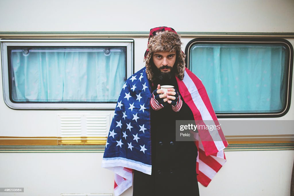 American guy on camping with USA flag : Stock Photo