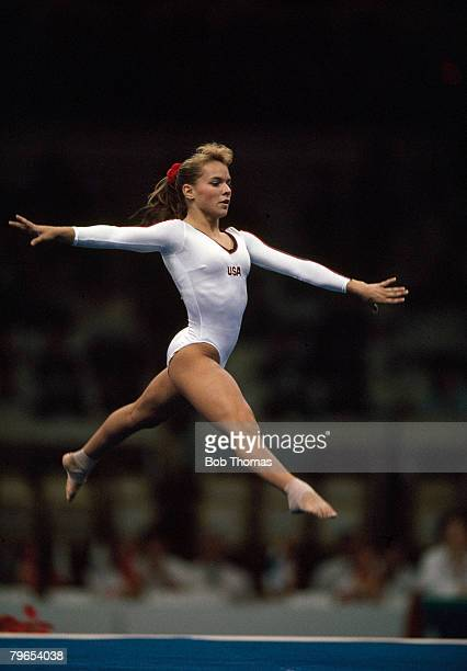 American gymnast Brandy Johnson pictured in action for the United States team on the floor exercise during competition in the Women's artistic team...