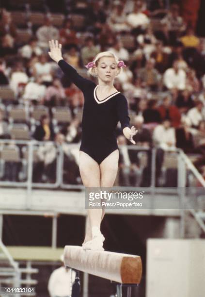 American gymnast Cathy Rigby pictured in action on the balance beam during competition for the United States team to finish in 4th place in the...