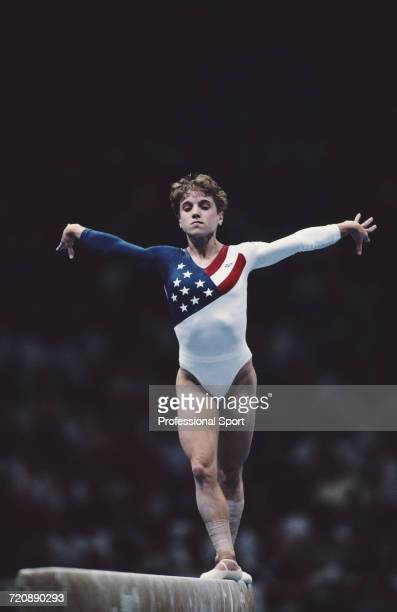 American gymnast Kerri Strug competes in the balance beam exercise for the United States women's gymnastics team to finish in first place to win the...