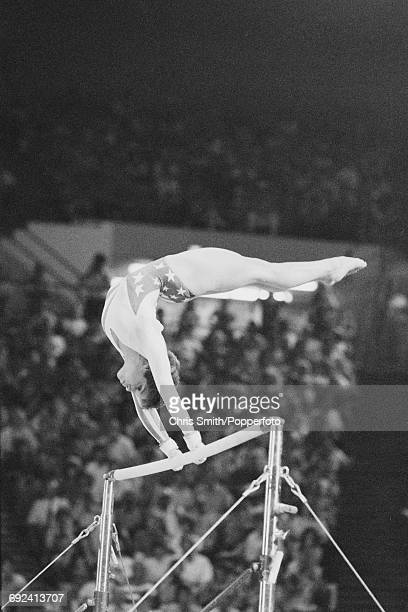 American gymnast Mary Lou Retton competes on the uneven bars during competition in the Women's artistic individual allaround event at the 1984 Summer...