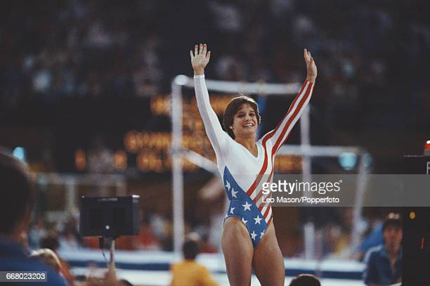 American gymnast Mary Lou Retton pictured raising her arms in the air during competition in the Women's artistic individual allaround event at the...