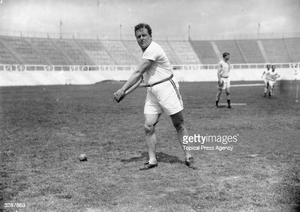 American hammer thrower John Flanagan trains for the 1908 London Olympics. He went on to win the gold medal.