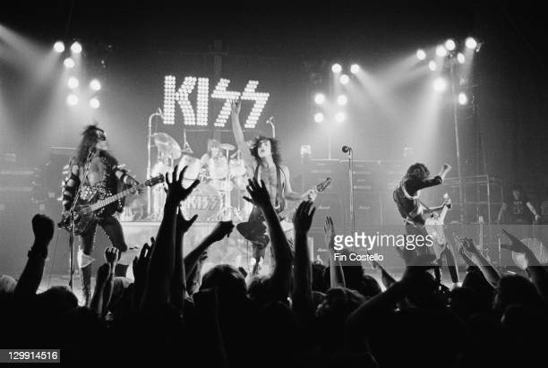 American heavy metal group Kiss performing at the Calderone Theater New York 24th August 1975 Left to right Gene Simmons Peter Criss Paul Stanley and...