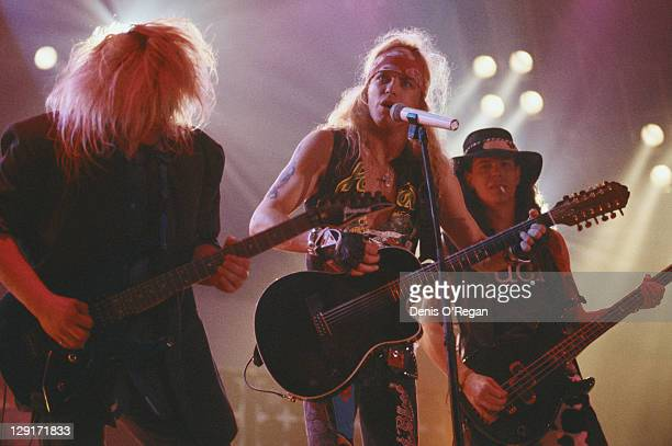 American heavy metal group Poison performing on stage March 1991 Left to right CC DeVille Bret Michaels and Bobby Dall