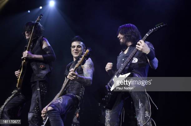 American heavy metal musicians from left guitarist Keri Kelli bassist Chuck Garric and guitarist Jason Hook perform with Alice Cooper at the Sears...