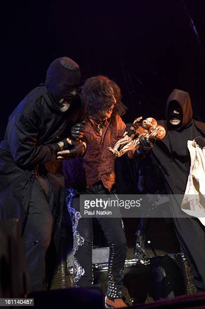 American heavy metal singer Alice Cooper and a pair of unidentified 'hangmen' perform at the Sears Centre in Hoffman Estates Illinois September 22...