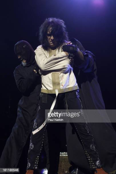 American heavy metal singer Alice Cooper and a pair of unidentified 'hangmen' perform at the Sears Centre in Hoffman Estates, Illinois, September 22,...