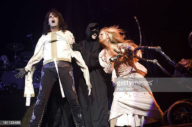American heavy metal singer Alice Cooper and his daughter actress and singer Calico Cooper perform with an unidentified 'hangman' at the Sears Centre...