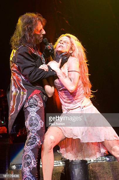 American heavy metal singer Alice Cooper and his daughter actress and singer Calico Cooper perform at the Sears Centre in Hoffman Estates Illinois...