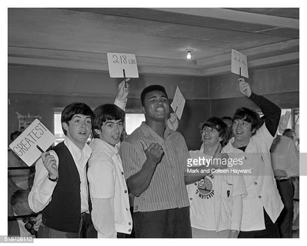 American heavyweight boxer Cassius Clay in a boxing ring with the Beatles at the 5th Street Gym Miami during the runup to his title fight against...