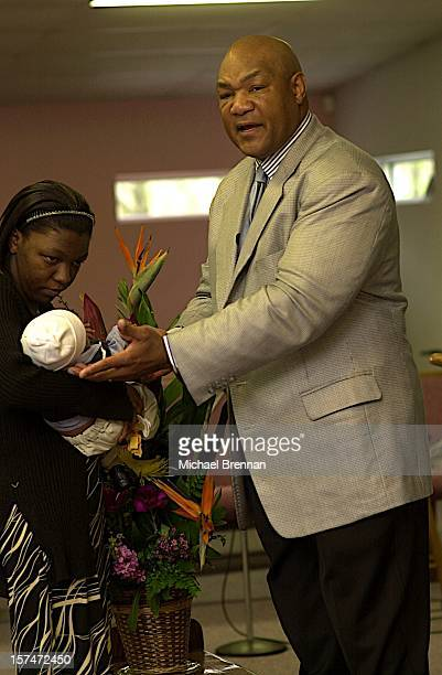 American heavyweight boxer George Foreman officiates at the baptism of a child at The Church Of The Lord Jesus Christ on Lone Oak Road in Houston,...