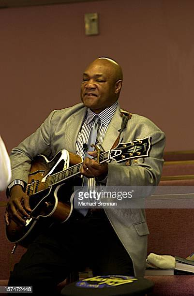 American heavyweight boxer George Foreman playing a guitar at The Church Of The Lord Jesus Christ on Lone Oak Road in Houston, Texas, March 2003....