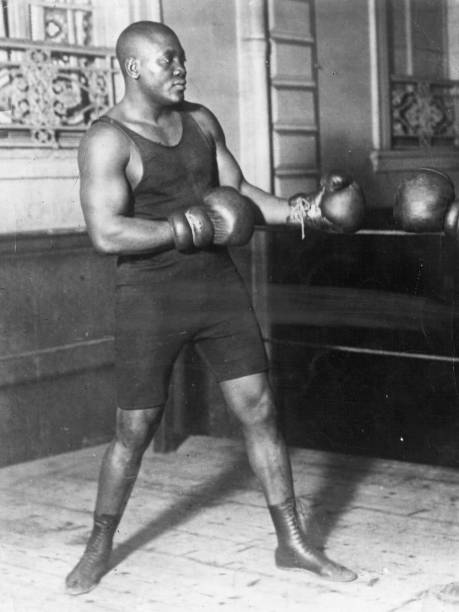 American heavyweight boxer Jack Johnson in action sparring....