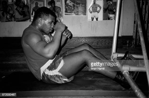 American heavyweight boxer Mike Tyson performs situps while training New York April 1987