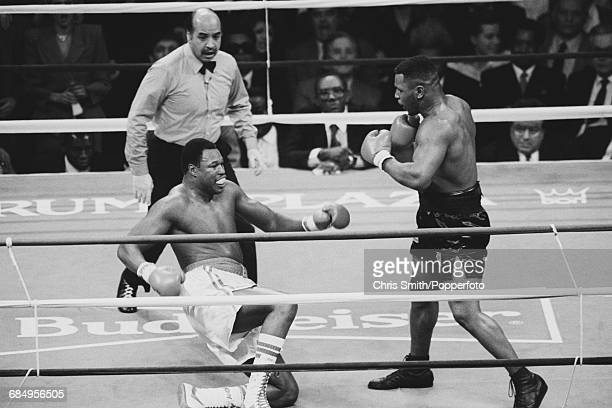 American heavyweight boxer Mike Tyson pictured right in action in his heavyweight title fight with Larry Holmes with referee Joe Cortez looking on at...