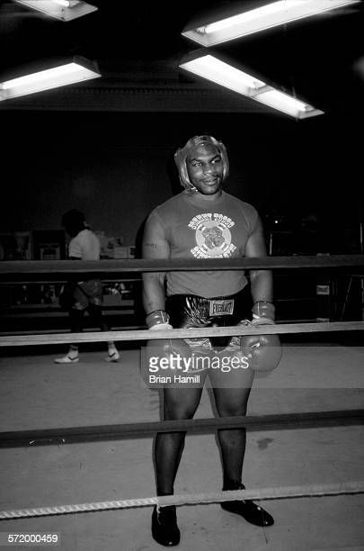American heavyweight boxer Mike Tyson stands in a ring during a practice bout New York April 1987