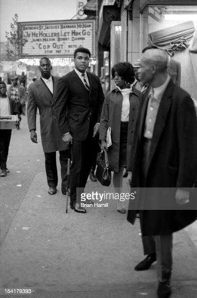 American heavyweight boxer Muhammad Ali and his entourage on a sidewalk in Harlem near the Apollo theatre New York New York October 11 1968