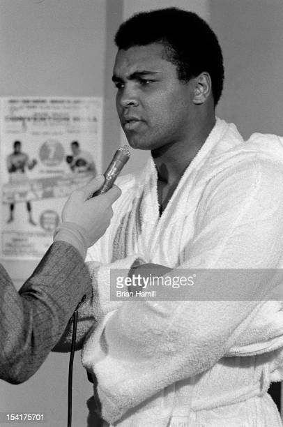 American heavyweight boxer Muhammad Ali dressed in a robe answers a reporter's questions during training at the 5th Street Gym Miami Florida 1971 Ali...