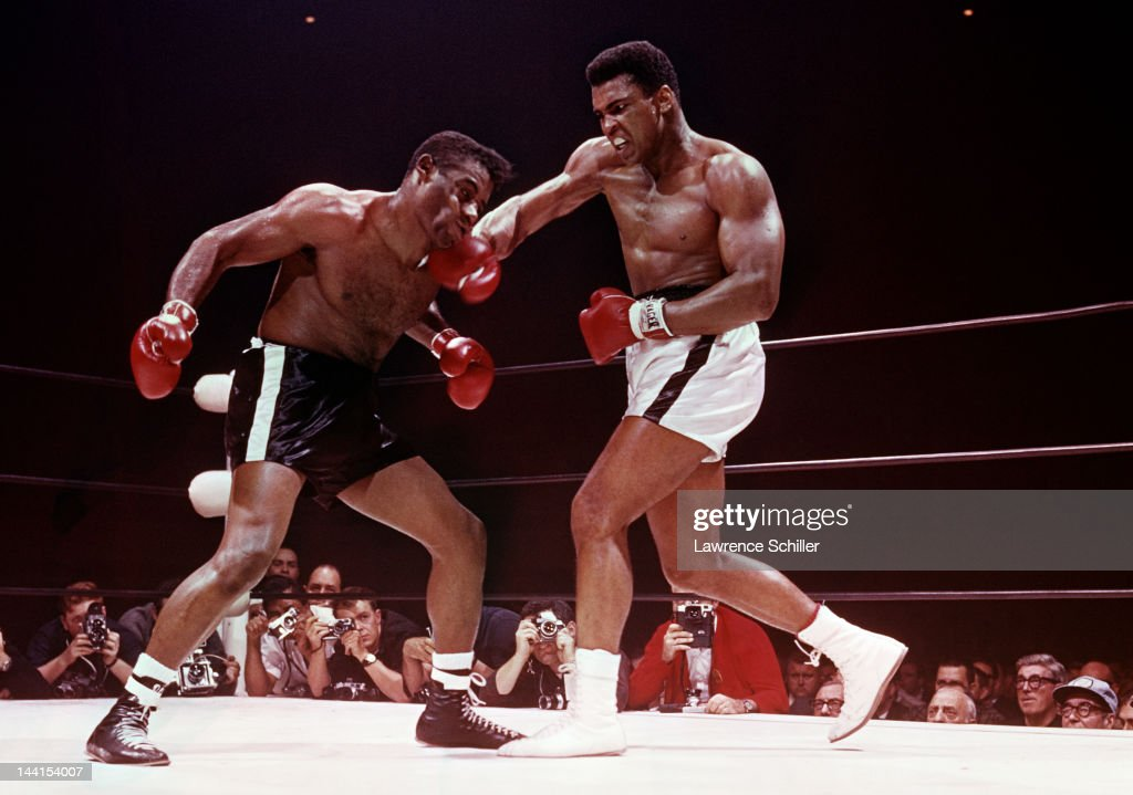 American heavyweight boxer Muhammad Ali (right) hits Floyd Patterson (1935 - 2006) during a bout at the Convention Center, Las Vegas, Nevada, November 22, 1965. Ali went on to win on the fight.