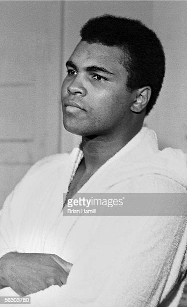 American heavyweight boxer Muhammad Ali sits in a robe with his arms folded as he prepares for his fight with Joe Frazier Miami Florida 1971