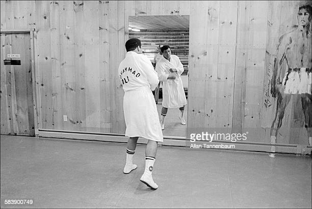 American heavyweight boxer Muhammad Ali watches himself in a mirror at his training camp Deer Lake Pennsylvania September 22 1977