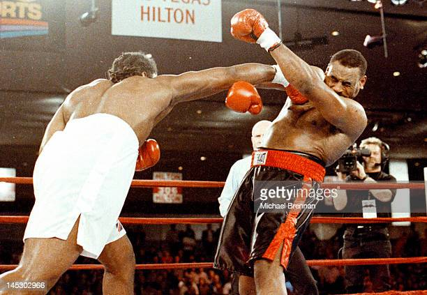 American Heavyweight boxer Oliver McCall receives a blow to the jaw from Lennox Lewis connects to McCall's jaw in the second round at the Hilton...