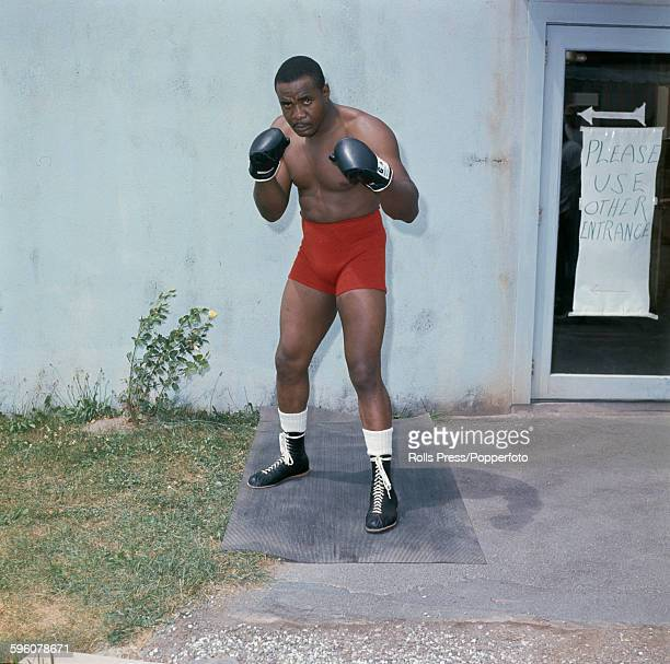 American heavyweight boxer Sonny Liston pictured in sparring pose during training circa 1965