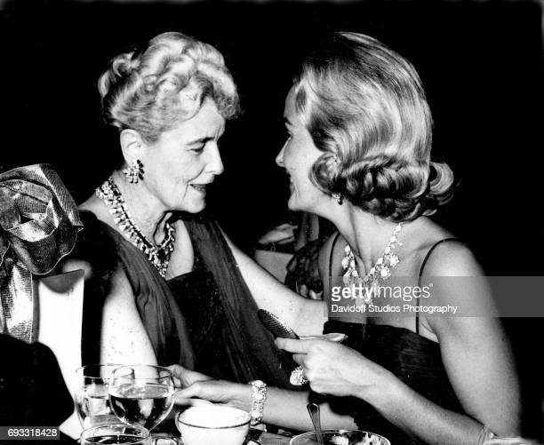 American heiress and businesswoman Marjorie Merriweather Post and her daughter Dina Merrill talk together during an unspecified event Florida March...