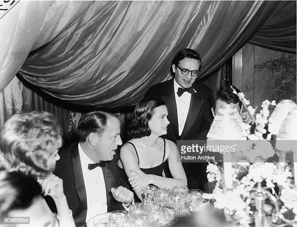 American heiress and designer Gloria Vanderbilt and her husband American film director at the Embassy Ball at the WaldorfAstoria New York early 1960s