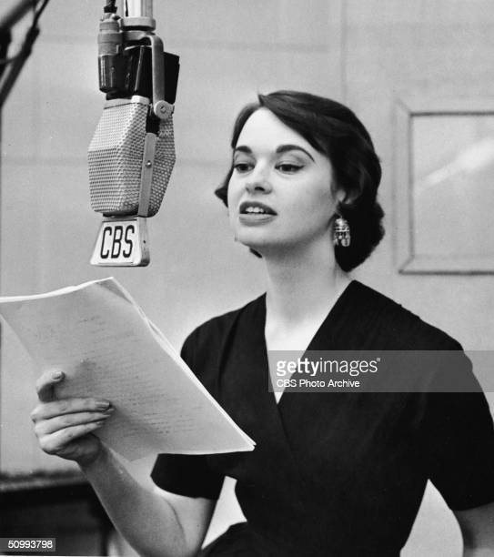 American heiress and socialite Gloria Vanderbilt discuss her poetry on the CBS Radio program 'The Music Room' where three of them set to music by...