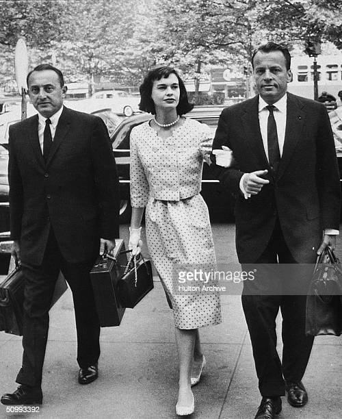 American heiress and socialite Gloria Vanderbilt walks with her attorneys on the way to a custody hearing with her former husband Leopold Stokowski...