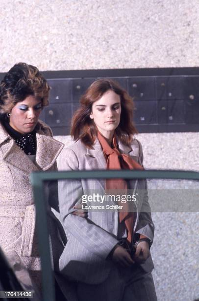 American heiress Patty Hearst is escorted by Federal Marshall Janey Jimenez from her holding cell during her trial for her role in the robbery of the...