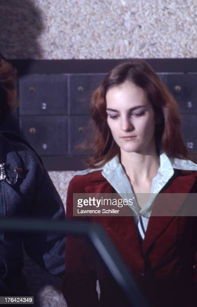 American heiress Patty Hearst is escorted from her holding cell during her trial for her role in the robbery of the Sunset District branch of...