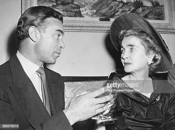 American heiress to the Woolworth estate Barbara Hutton makes a toast with her new husband Porfirio Rubirosa following their wedding in New York...