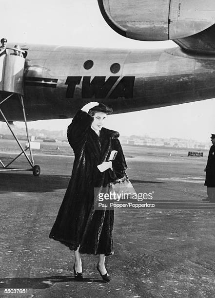 American heiress to the Woolworth estate Barbara Hutton wearing a fur coat as she arrives for her wedding to Porfirio Rubirosa in New York January...