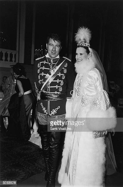 American heriess and designer Gloria Vanderbilt poses with her fourth husband actor and editor Wyatt Cooper at the Nine O'clocks Winter Ball in honor...