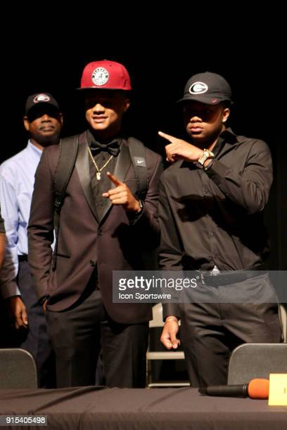 LAUDERDALE FL FEBRUARY American Heritage cornerback Patrick Surtain Jr and cornerback Tyson Campbell celebrate after signing their letters of intent...