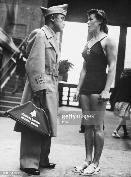 American high dive champion Sammy Lee with teammate Juno Stover at the Empire Pool in Wembley during the 1948 Summer Olympics in London UK 6th August...