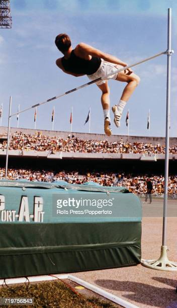 American high jumper Dick Fosbury pictured using the new 'Fosbury Flop' technique to clear the bar in competition to finish in first place to win the...