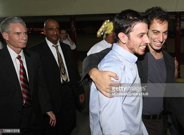 American hiker Josh Fattal is hugged by a family member after stepping off an Omani Royal Air Force plane on September 21 2011 in Muscat Oman after...