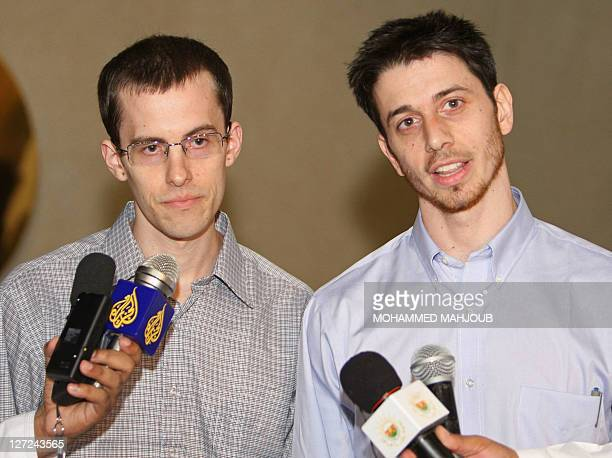 American hikers Shane Bauer and Josh Fattal hold a press conference after stepping off an Omani Royal Air Force plane on September 21 2011 in Muscat...