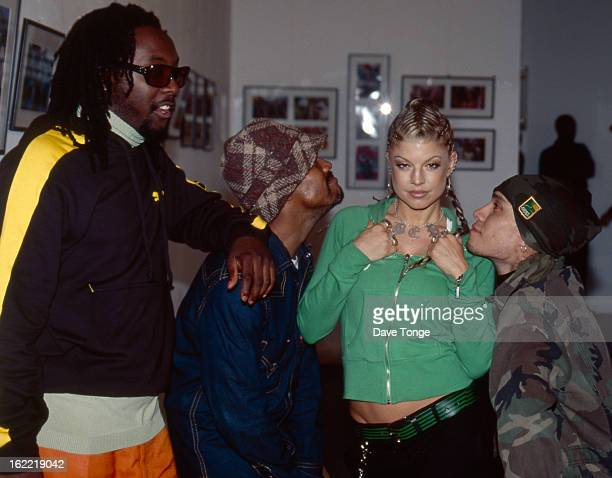 American hip hop group Black Eyed Peas back stage at TV show London circa 2003 Left to right william apldeap Fergie and Taboo