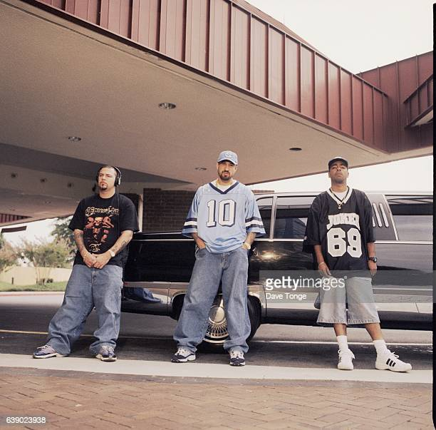 American hip hop group Cypress Hill pose by a limousine Los Angeles United States August 1998