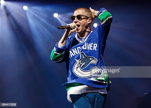 American hip-hop duo Macklemore of Macklemore and Ryan Lewis performs onstage during their North American 'The Unruly Mess I've Made' world tour at...