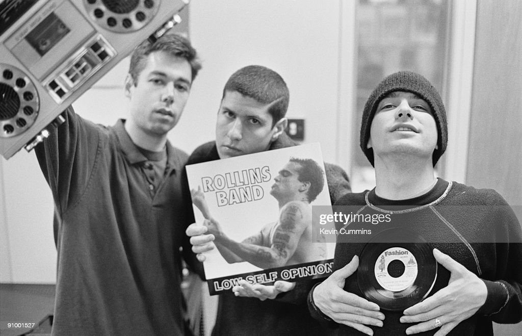 American hip-hop group the Beastie Boys reviewing the latest releases, 1992. Left to right: Michael 'Mike D' Diamond, Adam Ad-Rock' Horovitz and Adam 'MCA' Yauch. They are holding the singles 'Low Self Opinion' by Rollins Band and 'Played By Dis Ya Sound' by Bunny General.
